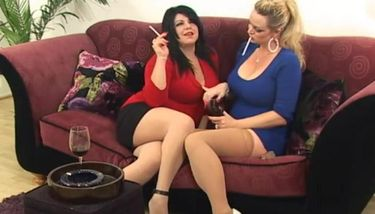 Smoking Mandy & her busty brunette friend smoking sexy corks ...